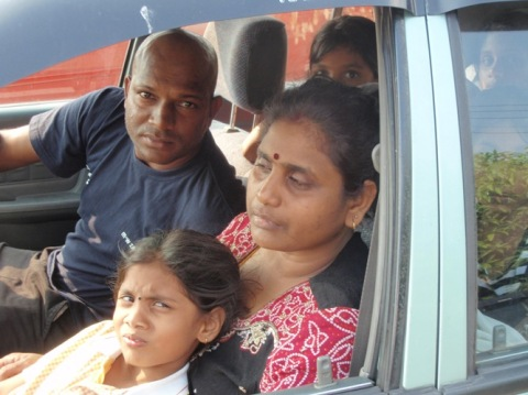Mohan, who is driving, is the younger brother of the deceased. On his left is the grieving mother of the late Kugan