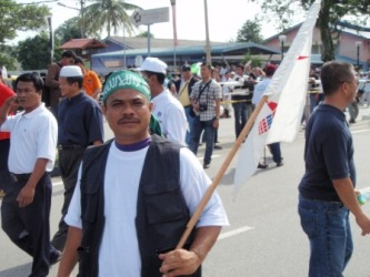 Ismail, with a PAS bandana and a DAP flag