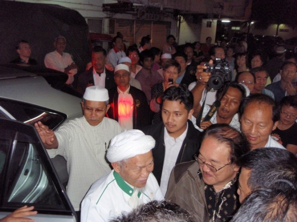 Nik Aziz being greeted at the entrance