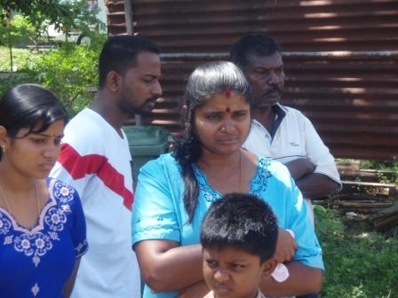 The lady in the light blue dress is Madam Gowri, sister of the late Gunasegaran