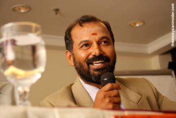 Thanenthiran in his dapper suit, a far cry from his street activism days. Photo courtesy of Malaysianinsider