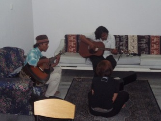 As the guests arrived on the outside, Meor ( left ) and Black were practising their rendition of their Saya Anak Bangsa Malaysia song on the inside